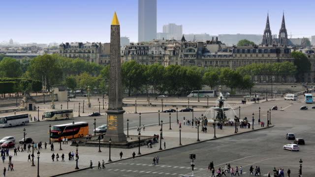 T/L WS HA Traffic on Place de la Concorde with Fountain of River Commerce and Navigation and Obelisk of Luxor / Paris, Ile de France, France