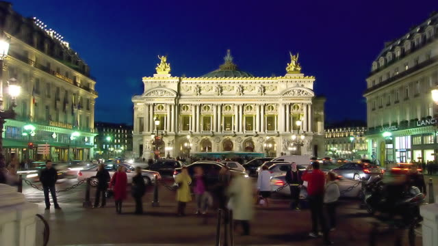 t/l ws traffic on place de l'opera with opera house in background at night, paris, france - place de l'opera stock videos and b-roll footage