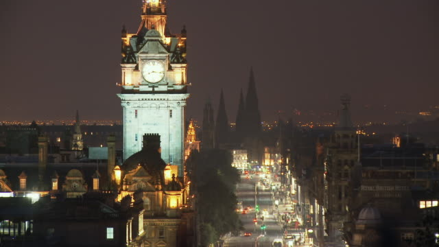 T/L, HA, WS, Traffic on Princes Street at night, Balmoral Hotel clock tower in foreground, Scotland, United Kingdom