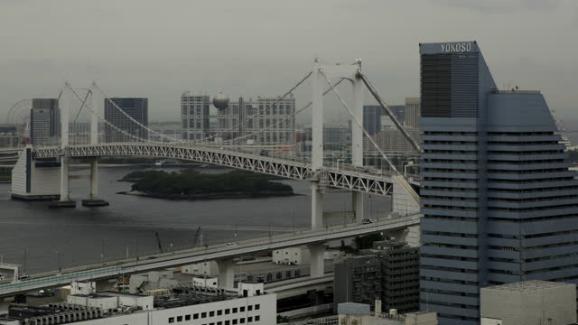 traffic on rainbow bridge tokyo and fuji tv / odaiba, tokyo, japan - minato ward stock videos & royalty-free footage