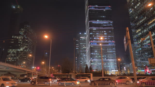 WS Traffic on road and illuminated skyscrapers at night, Chaoyang Road, Beijing, China
