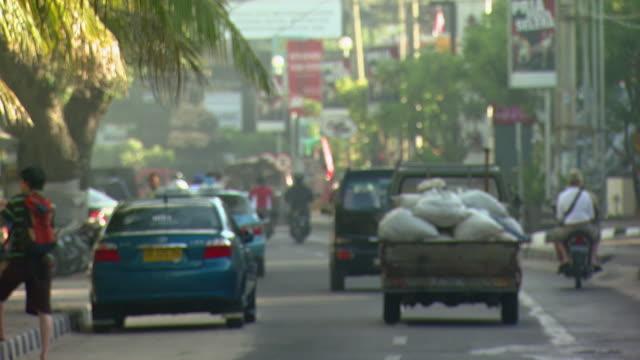 ws traffic on road / bali, indonesia - bali stock videos & royalty-free footage