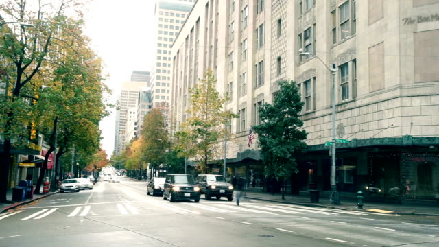 traffic on road in midtown of modern city timelapse - seattle stock videos & royalty-free footage