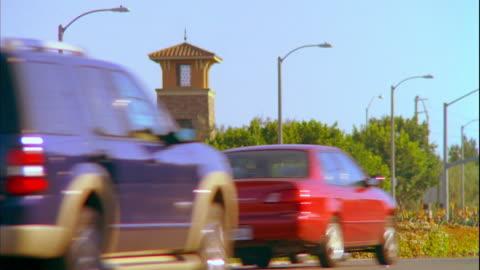 ws traffic on road with newport beach sign in background / laguna, california, usa - laguna beach california stock videos & royalty-free footage