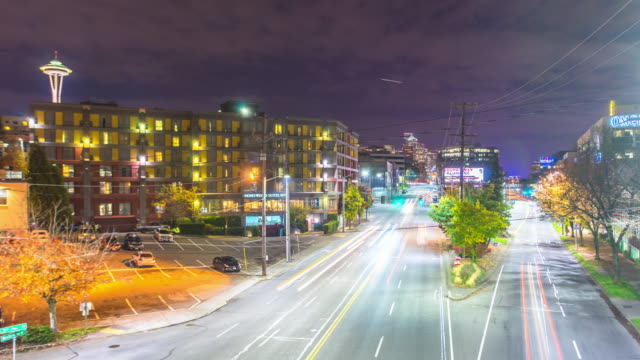 traffic on road,modern office buildings,cityscape and skyline at night in seattle. timelapse 4k