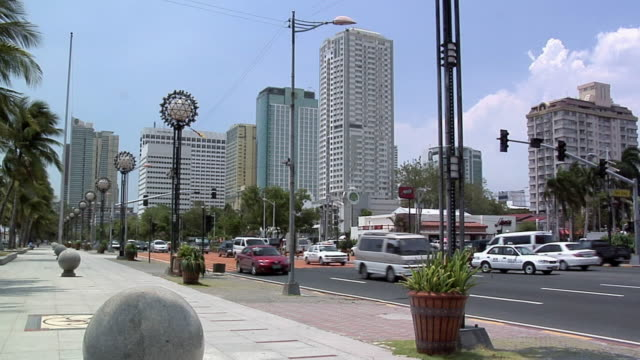 MS, Traffic on Roxas Boulevard, office buildings in background, Manila, Philippines