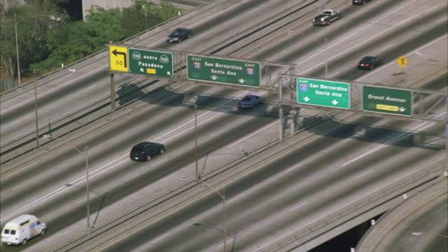 ws pov zo traffic on santa monica freeway with cityscape / california, usa - santa monica sign stock videos & royalty-free footage