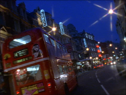 traffic on shaftesbury avenue at night / star filter - the strand london stock videos and b-roll footage