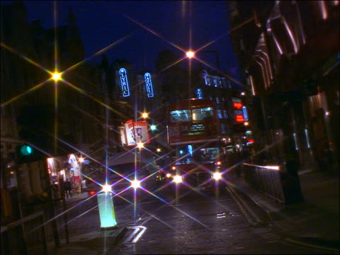 traffic on shaftesbury avenue at night towards camera / star filter - the strand london stock videos and b-roll footage