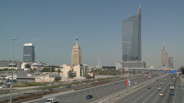 ws ha traffic on sheikh zayed road, hard rock cafe, aam tower (arenco tower) and burj al arab in background / dubai, united arab emirates - 2009 stock videos & royalty-free footage
