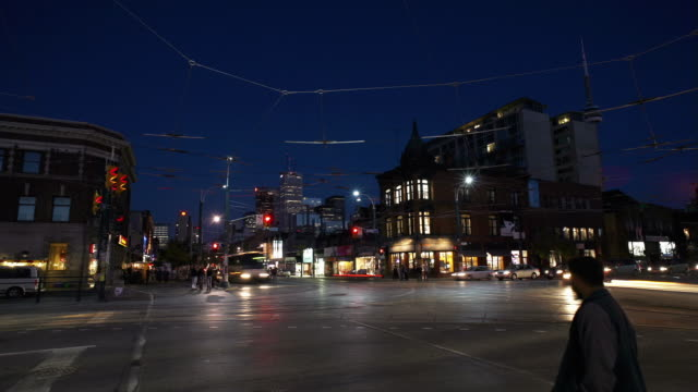 t/l, ms, traffic on spadina avenue and queen street intersection, toronto, ontario, canada - toronto stock videos & royalty-free footage