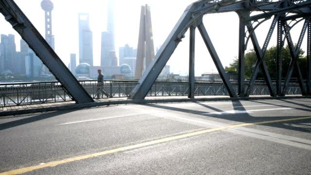 traffic on steel bridge in midtown of modern city