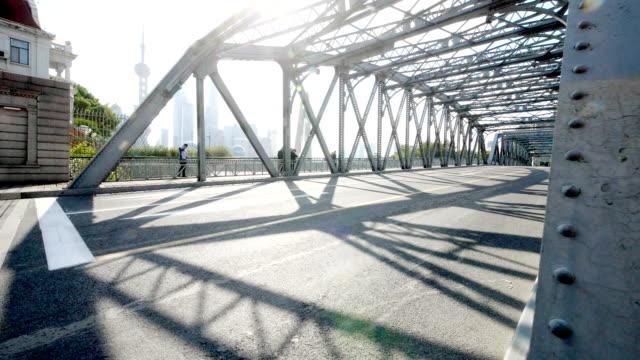 traffic on steel bridge in midtown of modern city - steel stock videos & royalty-free footage