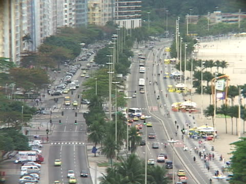 stockvideo's en b-roll-footage met ms ha traffic on street along copacabana beach / rio de janeiro, brazil - waaierpalm