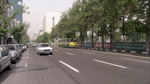 ws pan traffic on street and united states embassy, tehran, iran - us embassy stock videos & royalty-free footage