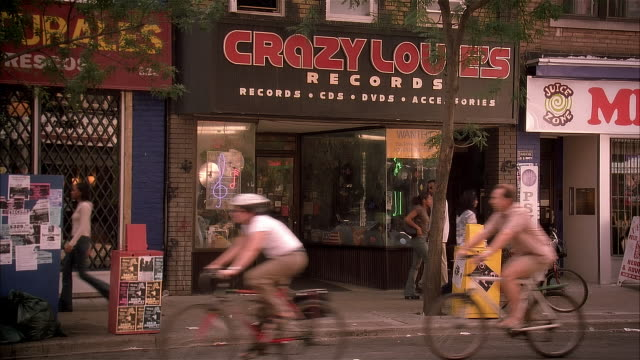 ms, traffic on street at crazy louis records shop, new york city, new york, usa - 2002 stock videos & royalty-free footage