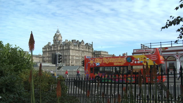 WS, Traffic on street, Balmoral Hotel in background, Edinburgh, Scotland, United Kingdom