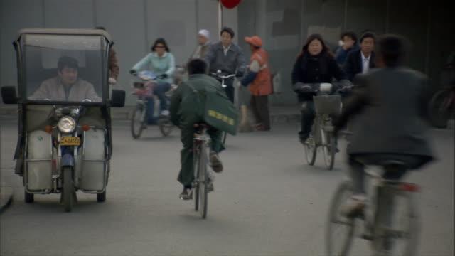 ms, traffic on street, beijing, china - pavement video stock e b–roll