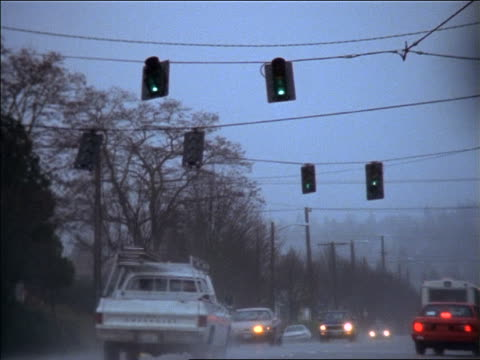 traffic on street beneath blowing traffic lights in bad windstorm / seattle - seattle stock videos & royalty-free footage