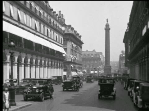 stockvideo's en b-roll-footage met b/w 1927 traffic on street leading to the colonne vendome / paris, france - colonne vendome