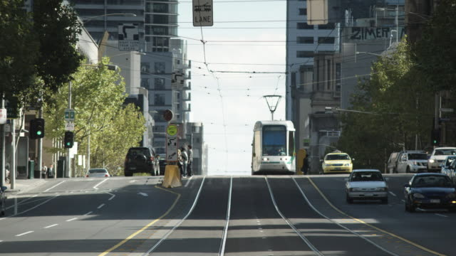 ws tu traffic on street, melbourne, victoria, australia - tram stock videos & royalty-free footage