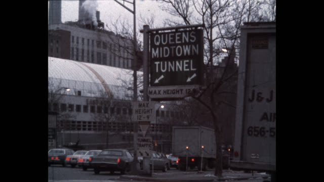 1979 traffic on street outside queens–midtown tunnel, new york city, new york state, usa - arrow symbol stock videos & royalty-free footage