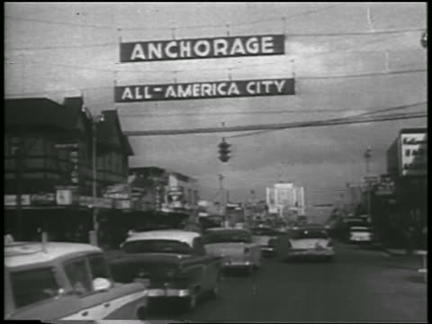b/w 1958 traffic on street with anchorage allamerica city sign above / alaska / newsreel - 1958 stock videos & royalty-free footage