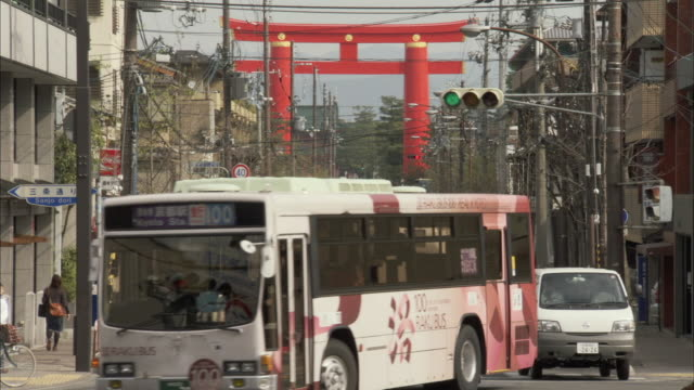 WS Traffic on street with torii gate in background / Kyoto, Kyoto Prefecture, Japan