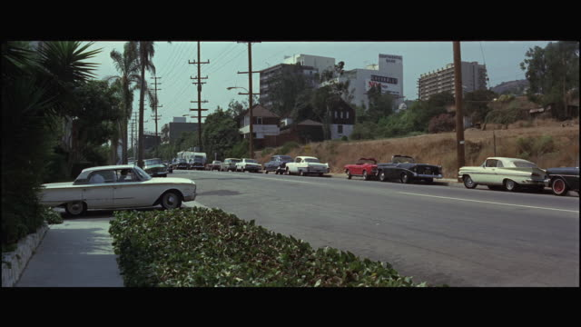 vidéos et rushes de 1967 ws traffic on sunset boulevard / los angeles, california, usa - 1967