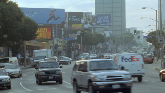 traffic on sunset boulevard passes by tower records. - tower records stock videos & royalty-free footage