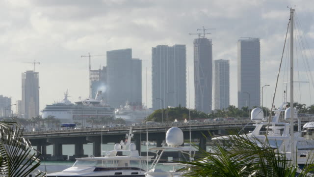 traffic on the bridge and cruise ship leaving miami - heat haze stock videos & royalty-free footage