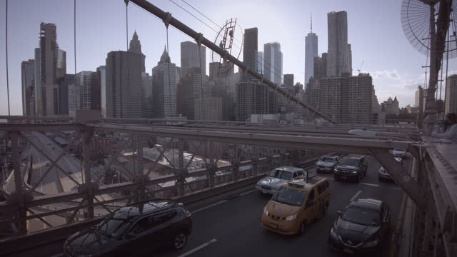 traffic on the brooklyn bridge in new york city, new york on may 14, 2021. - yellow taxi stock videos & royalty-free footage