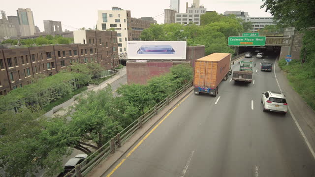 traffic on the brooklyn queens expressway in brooklyn heights, new york city, new york on june 11, 2021. - noise stock videos & royalty-free footage
