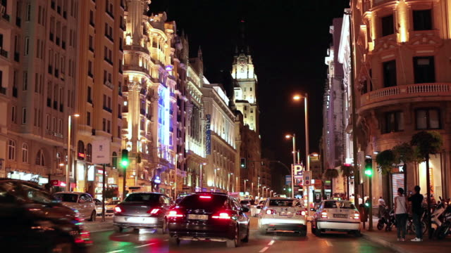 ws traffic on the gran via at night / madrid, spain - b roll stock videos & royalty-free footage