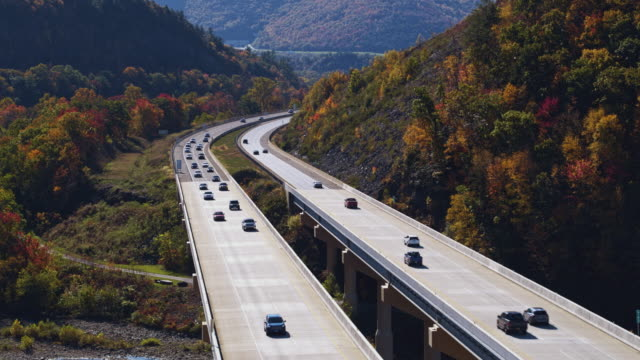 traffic on the high bridge at the pennsylvania turnpike in fall. aerial video with the forward camera motion - pennsylvania stock videos & royalty-free footage