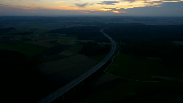 stockvideo's en b-roll-footage met aerial traffic on the highway viaduct at dusk - horizon