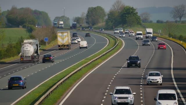 traffic on the m6 motorway near carlisle in cumbria england uk - main road stock videos & royalty-free footage