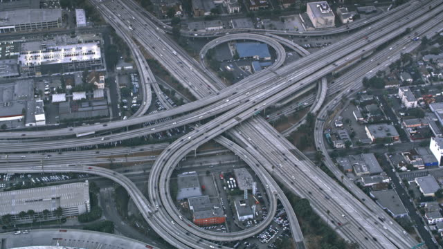 aerial traffic on the massive highway intersection in los angeles, ca - gray color stock videos & royalty-free footage