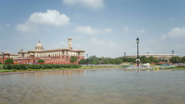 Traffic on the Raj Path speeds past the Parliament Building in New Delhi.