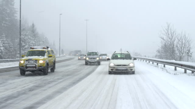 traffic on the snowy highway - rear view stock videos & royalty-free footage