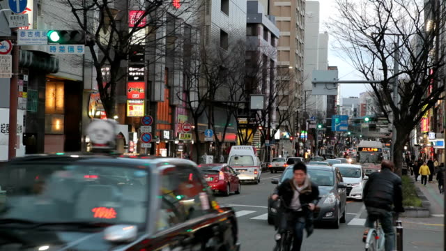 traffic on the street in the fukuoka city, japan - fukuoka prefecture stock videos and b-roll footage