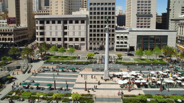 T/L WS HA Traffic on Union Square with Dewey Monument pedestrians and traffic / San Francisco, California, USA