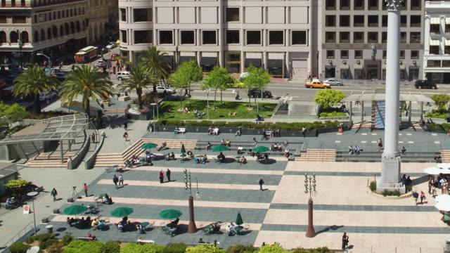 T/L WS HA TU Traffic on Union Square with Dewey Monument pedestrians and traffic / San Francisco, California, USA