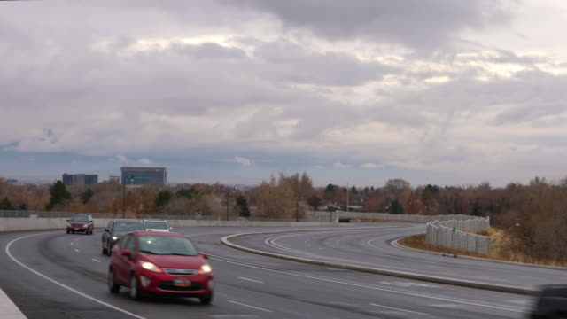 traffic on university parkway as clouds move through the sky - provo stock videos & royalty-free footage