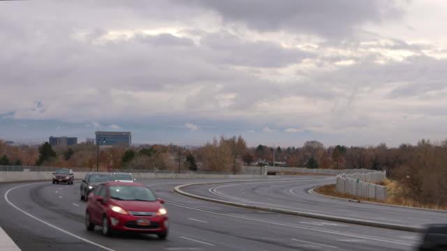 traffic on university parkway as clouds move through the sky - provo bildbanksvideor och videomaterial från bakom kulisserna