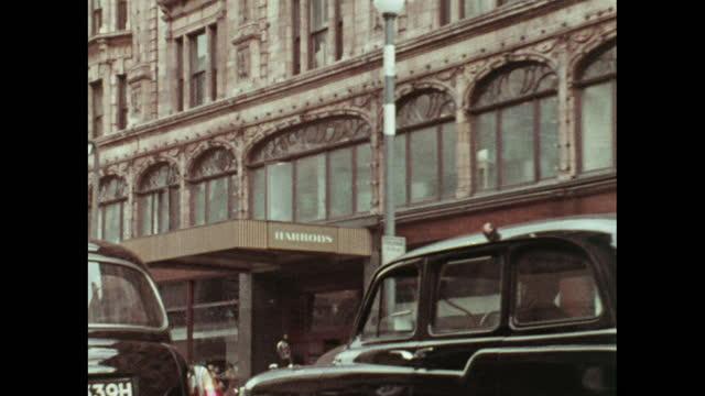 traffic outside harrods, london; 1970 - double decker bus stock videos & royalty-free footage