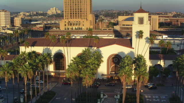 traffic outside union station, los angeles - drone shot - union station los angeles stock videos & royalty-free footage