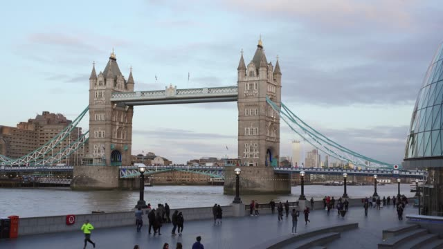 traffic over tower bridge from busy st. katherines dock, london, england, united kingdom, europe - river thames stock videos & royalty-free footage