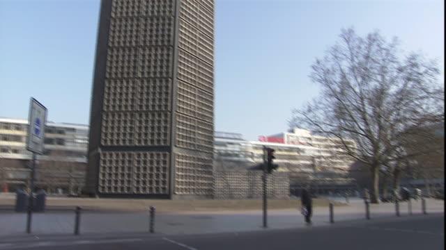 traffic passes a modern high rise and the kaiser wilhelm memorial church in berlin. - カイザー・ヴィルヘルム記念教会点の映像素材/bロール