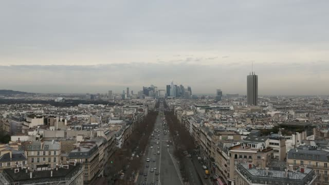 Traffic passes along Avenue de la Grande Armee as skyscrapers stand beyond in the LA Defense business district in Paris France on Tuesday Feb 18 Wide...